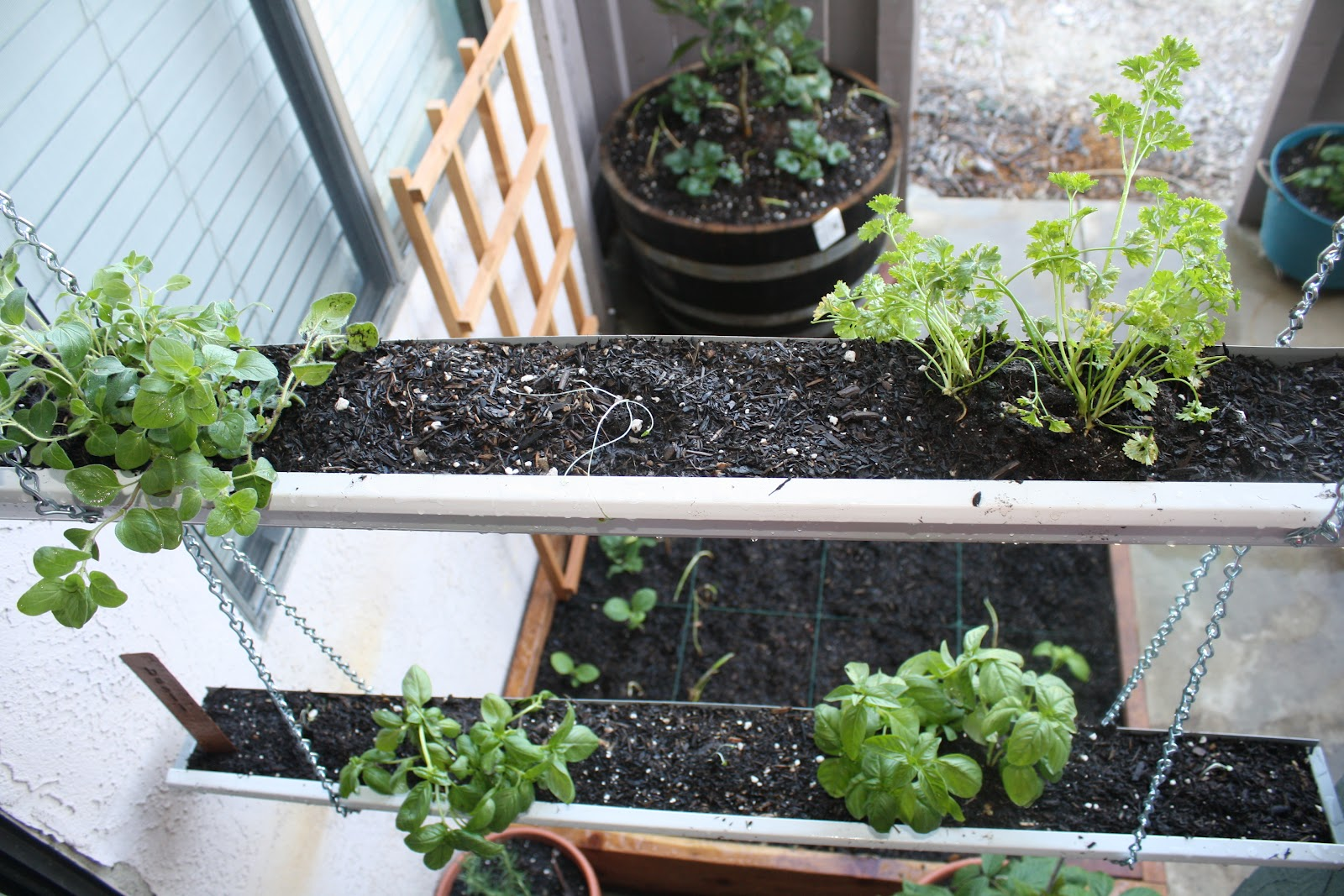 13 creative and innovative rain gutter garden ideas the for Rain gutter planter box