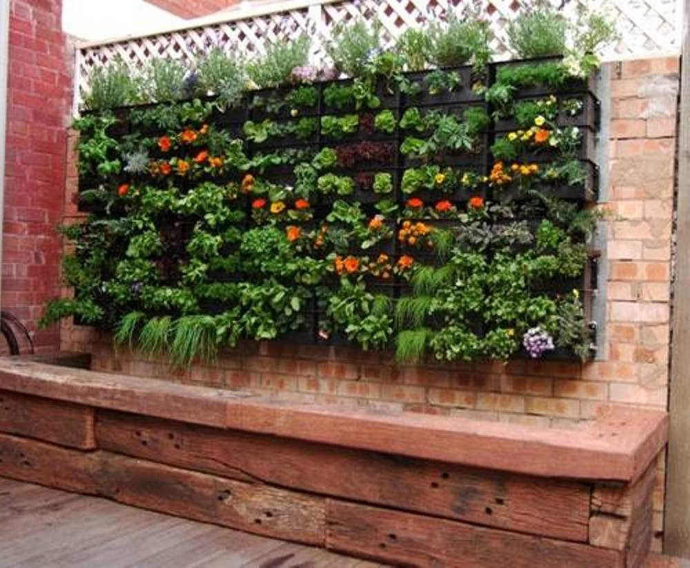Small Garden Wall Ideas best small garden ideas sandstone paving stones privacy wall modern outdoor furniture water feature Small Space Gardening 20 Clever Ideas To Grow In A Limited Space
