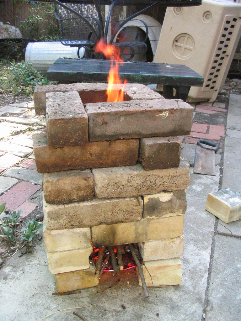 12 rocket stove plans to cook food or heat small spaces for Most efficient rocket stove design