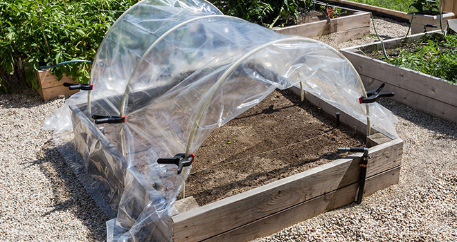 12 hoop house plans to enjoy gardening throughout winter for Portable greenhouse plans