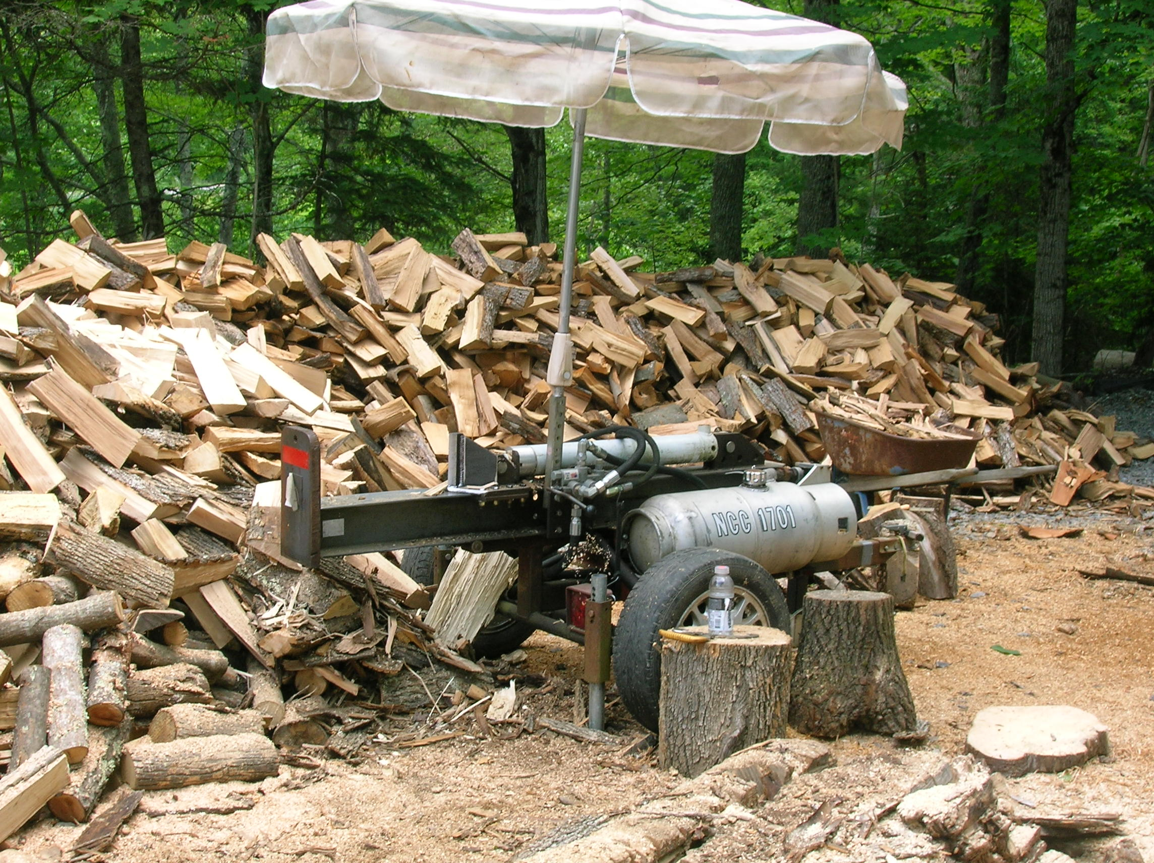 12 homemade log splitters that make cutting of firewood for Homes built on your land with no money down