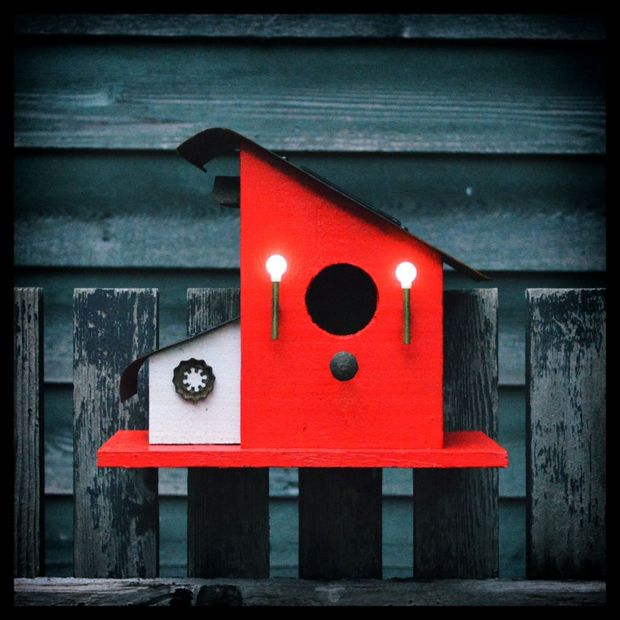 A Birdhouse With Night Lights