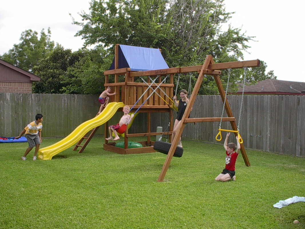 15 diy swing set build a backyard play area for your kids for Building a wooden swing