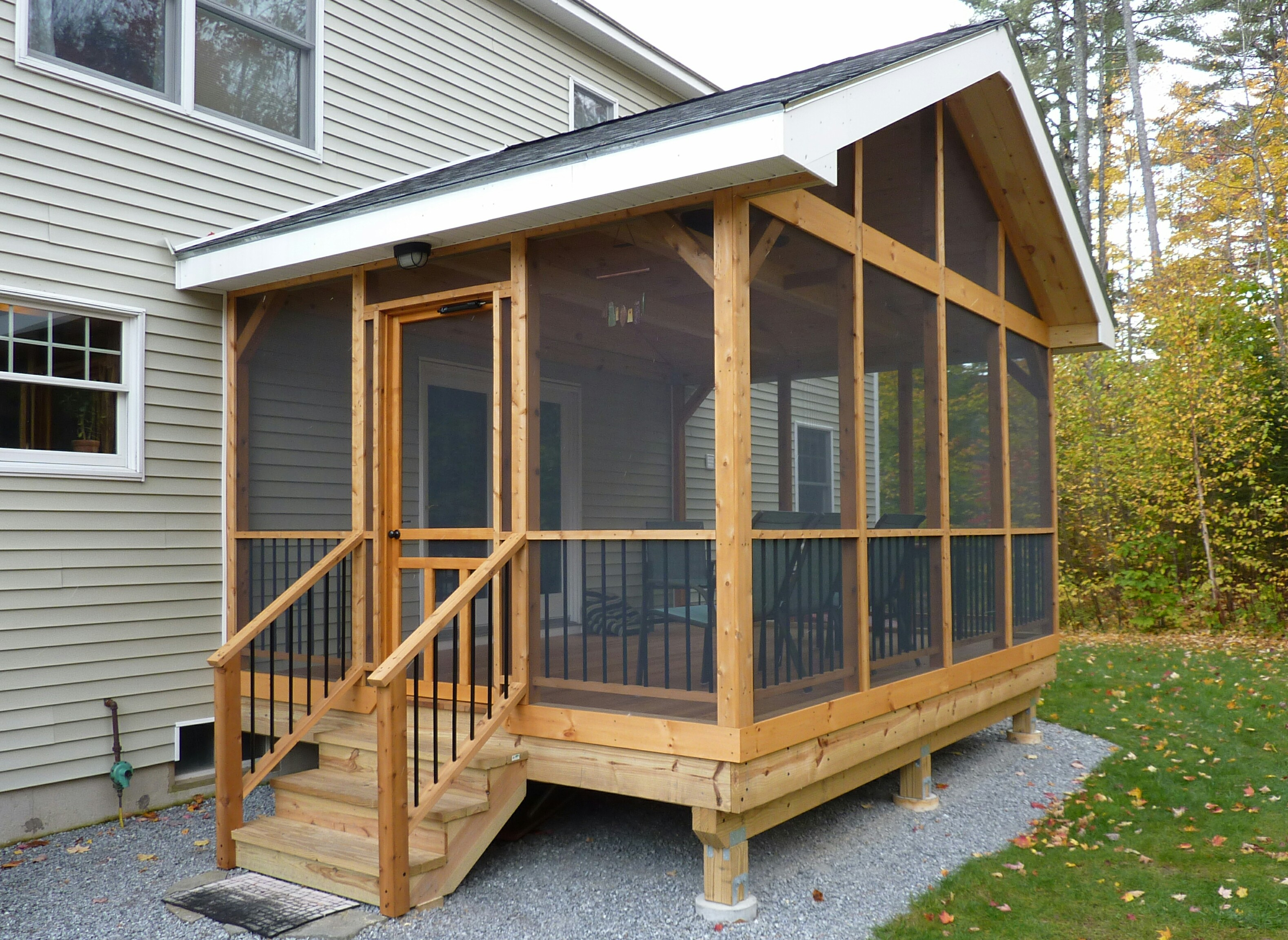 15 diy screened in porch learn how to screen in a porch for Building a front porch deck